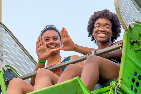 Students riding Ferris Wheel at Canes Carnival